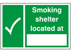 Smoking shelter located at sign