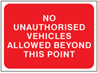 No unauthorised vehicles allowed beyond this point temporary road sign.