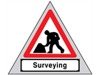 Men at work, surveying roll up road sign