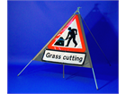 Men at work, grass cutting roll up road sign