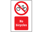 No bicycles symbol and text safety sign.