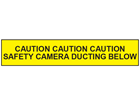 Caution safety camera ducting below tape.