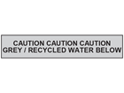 Caution grey or recycled water below tape.