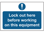Lock out here before working on this equipment sign.