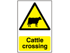 Cattle crossing warning sign.