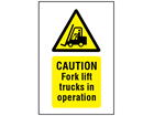 Caution Fork lift trucks in operation symbol and text safety sign.