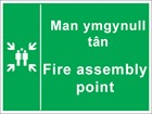 Man ymgynull tân / Fire assembly point. Welsh English sign