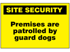 Premises are patrolled by guard dogs sign