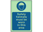 Safety helmets must be worn in this area photoluminescent safety sign