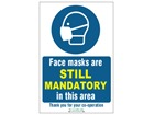 Face masks are still mandatory in this area safety sign.