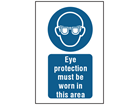 Eye protection must be worn in this area symbol and text safety sign.