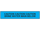 Caution brine water main below tape.