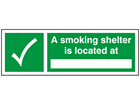 A smoking area is located at sign