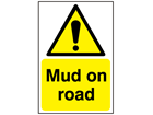Mud on road warning sign.