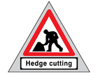 Men at work, hedge cutting roll up road sign