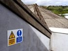 Danger Asbestos roof, Permit to work required safety sign.