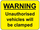 Warning Unauthorised vehicles will be clamped sign