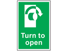 Turn to open clockwise symbol and text safety sign.