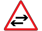 Two-way traffic crosses one way road sign