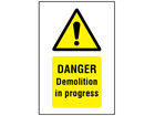 Danger Demolition in progress symbol and text safety sign.