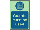 Guards must be used photoluminescent safety sign