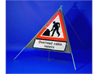 Overhead cable repairs roll up road sign