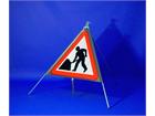 Men at work roll up road sign