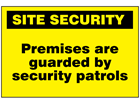 Premises are guarded by security patrols sign