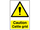 Caution cattle grid safety sign.