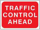 Traffic control ahead temporary road sign.