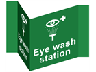 Eye wash station projecting safety sign.