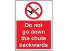 Do not go down the chute backwards sign.