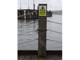 Caution, Deep water symbol and text safety sign.