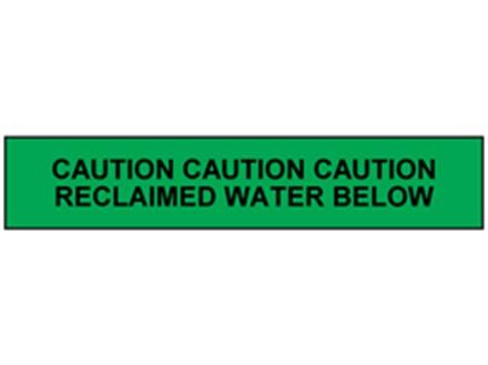 Caution reclaimed water below tape.