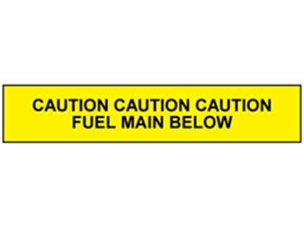 Caution fuel main below tape.