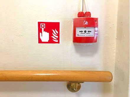 Fire alarm call point symbol safety sign.