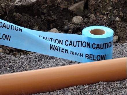 Caution water main below tape.