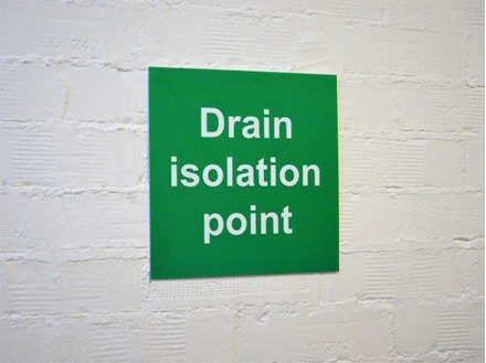 Drain isolation point sign.