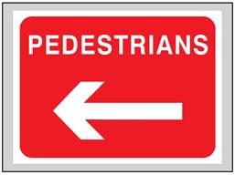 Pedestrians (arrow left) roll up road sign