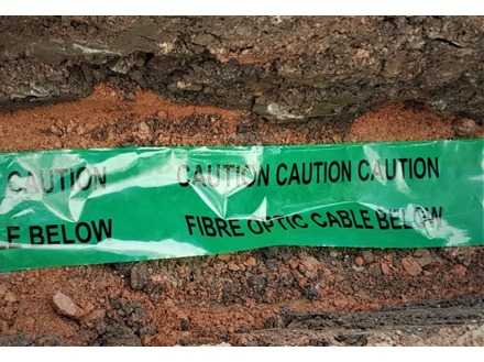 Caution fibre optic cable below tape.