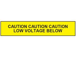 Caution low voltage below tape.