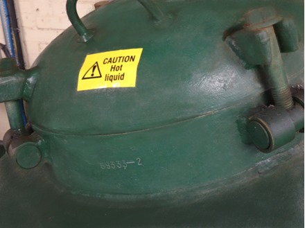 Caution hot liquid symbol and text safety sign.