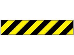 Laminated warning tape, black and yellow chevron.
