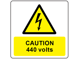 Caution 440 volts symbol and text safety label.