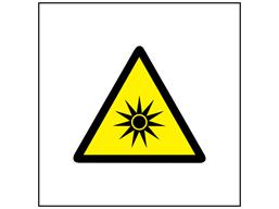 Caution optical radiation hazard symbol safety sign.