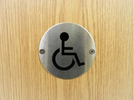 Disabled symbol door sign.