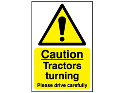 Caution, tractors turning, please drive carefully safety sign.