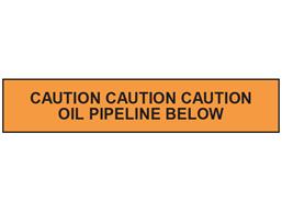 Caution oil pipeline below tape.