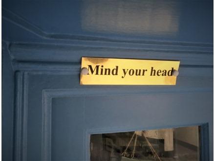 Mind your head metal doorplate