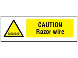 Caution Razor wire safety sign.